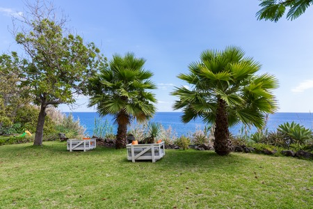 Vacation resort with comfortable seats near the sea at Madeira Island, Portugal photo