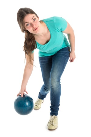 Woman throwing a bowling ball, isolated over white