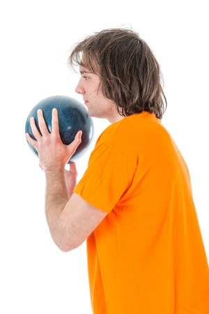 bowling ball: Man is ready to throw a bowling ball, isolated over white Stock Photo