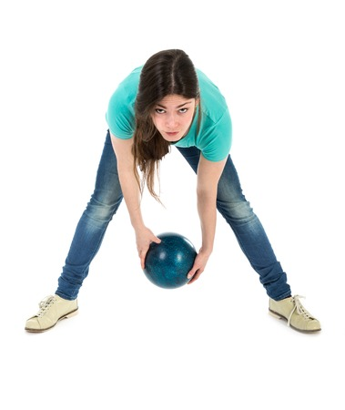 Woman is throwing a bowling ball at a simplistic way, isolated over white