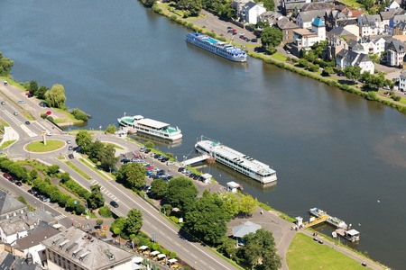 passenger ships: Aerial view Moselle with moored passenger ships near Traben-Trarbach in Germany Stock Photo