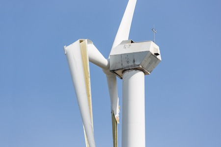 Wind turbine with broken wings after a heavy spring storm in the Netherlands