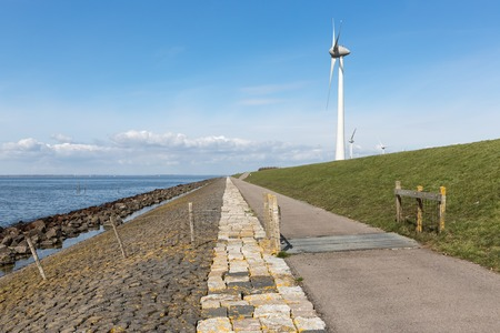 windturbines: Dutch coastline with dike and huge wind turbines