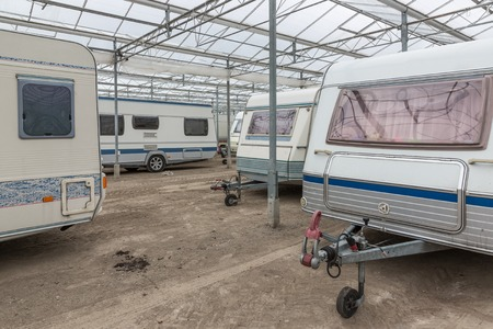 Caravan parking in an empty Dutch Greenhouse Stockfoto