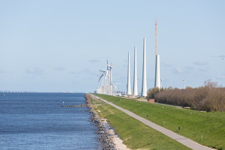 the existing: Construction of a new windfarm along the Dutch coast with the old existing smaller windturbines still in production