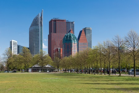 city park: Skyline The Hague with big skyscrapers and city park The Netherlands Stock Photo