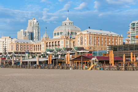 scheveningen: SCHEVENINGEN THE NETHERLANDS APR 30: View from the beach at the famous Kurhaus with some restaurants in front of it on April 30 2015 Scheveningen The Netherlands Editorial