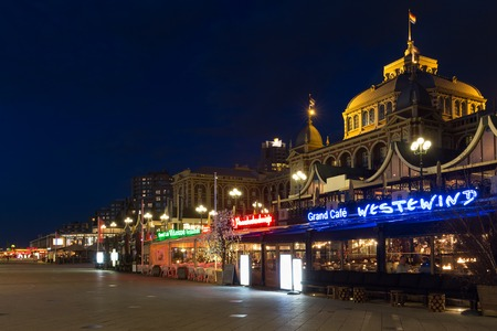 scheveningen: SCHEVENINGEN THE NETHERLANDS APR 30: Night view at beach boulevard with famous Kurhaus and people eating in restaurants on April 30 2015 Scheveningen The Netherlands Editorial