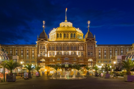 scheveningen: SCHEVENINGEN THE NETHERLANDS APR 30: Night view of the famous Kurhaus hotel in the evening on April 30 2015 near the coast of Scheveningen The Netherlands
