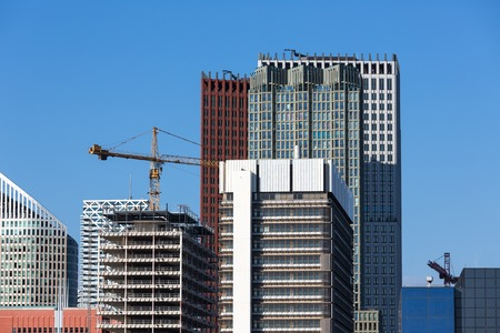 high rises: Skyscrapers with the construction of a new office building Stock Photo