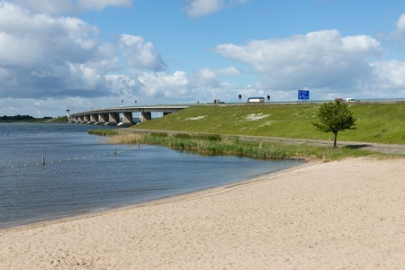 Dutch beach and highway with concrete bridge between Emmeloord and Lelystad Stock Photo