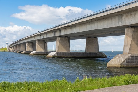Big concrete bridge over Dutch lake near Lelystad 스톡 콘텐츠