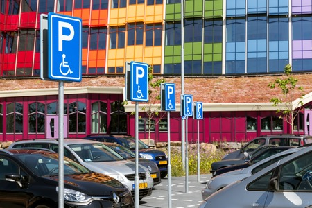 Zwolle THE NETHERLANDS JUN 11: Car park with special handicapped parkingplaces in Reviews front of the Isala Hospital Zwolle on June 11 2015 in the Zwolle the Netherlands