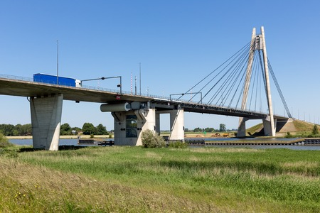ijssel: River IJssel with floodplain and crossing bridge near Kampen in The Netherlands Stock Photo