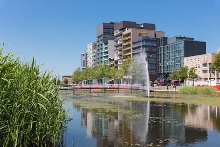 lelystad: View at modern apartments and office buildings with pond and fountain in front of it Lelystad the Netherlands