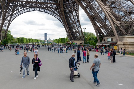 substructure: PARIS, FRANCE - May 28: Tourists near the Eiffel tower, main attraction of Paris  on May 28, 2015, Paris, France Editorial