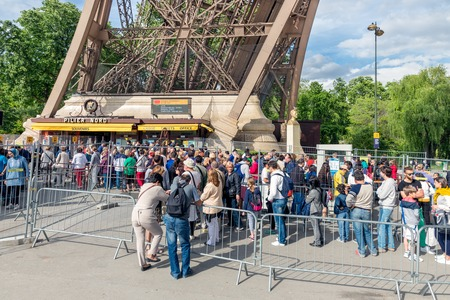ticket office: PARIS, FRANCE - May 28: Tourists waiting near a ticket office of the Eiffel tower, main attraction of Paris on May 28, 2015, Paris, France