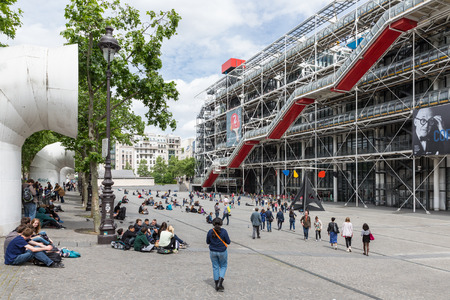 PARIS, FRANCE - MAY 29: Tourists sitting and relaxing at the plaza in front of the Centre Pompidou on May 29, 2015 in Paris, France