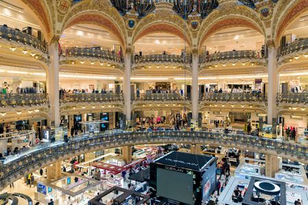 lafayette: PARIS, FRANCE - MAY 29: Unknown people shopping in famous luxury Lafayette department store on May 29, 2015 in Paris, France