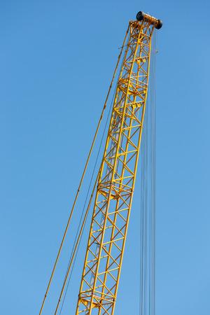 jib: Detail yellow crane jib against a blue sky