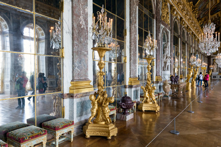 admiring: VERSAILLES PARIS, FRANCE - MAY 30: Visitors admiring the Hall of Mirrors on May 30, 2015 at the Palace of Versailles near Paris, France Editorial
