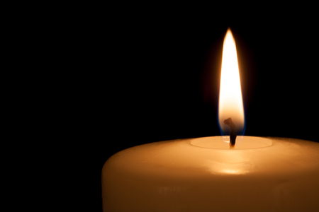 candle: Burning candle in the dark with free copy space Stock Photo