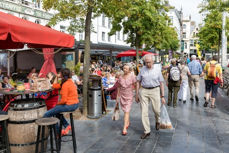 lounging: ANTWERP, BELGIUM - AUG 11: Lounging people and relaxing tourists at terraces downtown in the city Antwerp on August 11, 2015 in Antwerp, Belgium