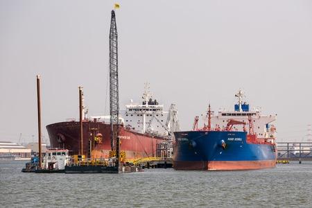 antwerp: ANTWERP, BELGIUM - AUG 13: Harbor of Antwerp with moored big cargo ships on August 13, 2015 in the harbor of Antwerp, Belgium Editorial