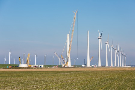 agricultural engineering: Construction site of new Dutch wind farm in agricultural landscape Stock Photo