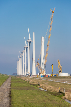 Construction site of new Dutch wind farm in agricultural landscape Stock Photo