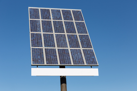 hoarding: Blue sky and solar panel with hoarding and free copy space for text