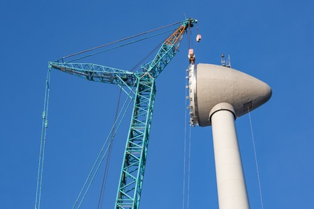 rotor: Construction site new wind turbine with hoisting of rotor house