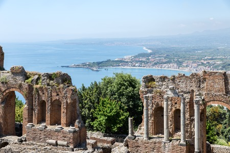 southward: Ancient Greek theater of Taormina city with a panorama southward at the Sicilian island and the Mediterranean Sea