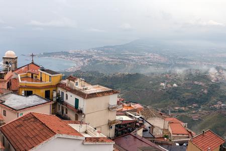 southward: Panorama of Castelmola near Taormina and southward an aerial view at the Sicilian Coast with raining clouds