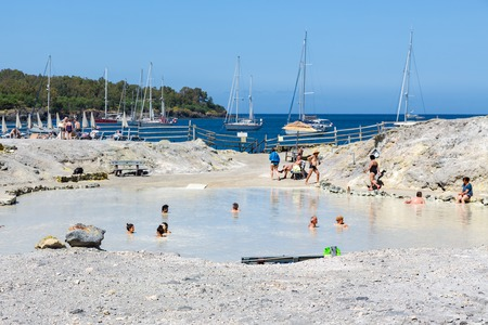 aeolian: VULCANO, ITALY - MAY 24: People relaxing in healthy mud pool on May 24, 2016 at Aeolian Islands near Sicily, Italy Editorial