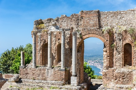 southward: Ancient Greek theater of Taormina city with a by look at the Sicilian island and the Mediterranean Sea Stock Photo