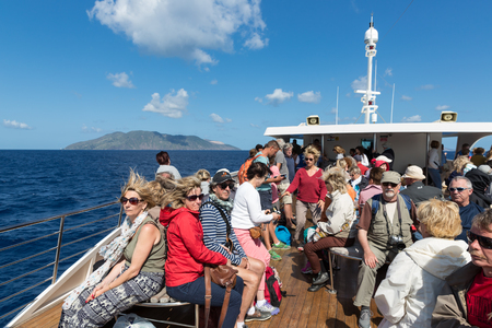lipari: LIPARI,  ITALY - MAY 23: Cruise ship with tourists visiting the Aeolian Islands on May 24, 2016 at Sicily, Italy