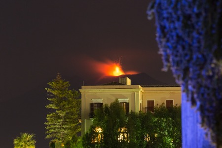 kilometre: Eruption of Sicilian volcano Etna at night, seen from Taormina at 15 kilometre away. Stock Photo