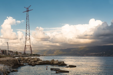to the other side: Sunset at coast of Sicily near Messina. At the other side of the water the mainland of Italy Stock Photo