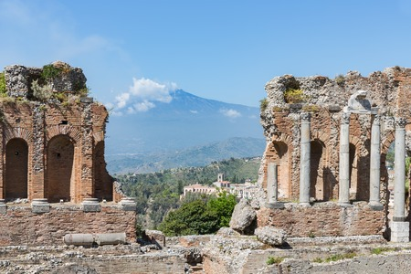 southward: Ancient Greek theater of Taormina city with a panorama at the Etna at the island Sicily, Italy