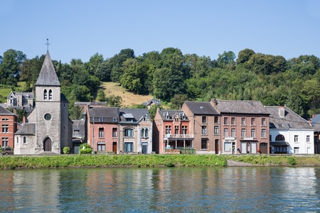 meuse: Houses and little church along river Meuse in Dinant, Belgium