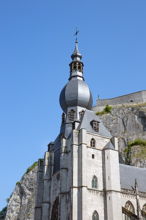 Looking up to the Church and citadel of Dinant, Belgium