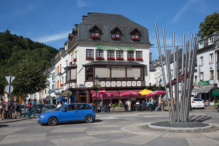 the ardennes: BOUILLON, BELGIUM - AUG 13: Belgian medieval city along river Semois in Ardennes with tourists relaxing in the centre of the city on August 13, 2016 in Bouillon, Belgium