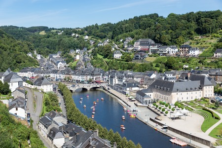 BOUILLON, BELGIUM - AUG 13: Aerial view of medieval city Bouillon with pedalos in river Semois on August 13, 2016 in Bouillon, Belgium