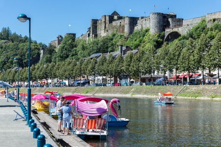 BOUILLON, BELGIUM - AUG 13: Bouillon with castle and river Semois with pedalos for recreation on August 13, 2016 in Bouillon, Belgium Editorial