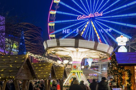 DUISBURG, GERMANY - DECEMBER 17, 2016: Traditional christmas market with illuminated carrousel and ferris wheel in the center of Duisburg, Germany
