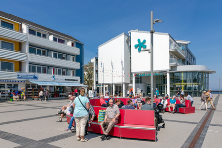 HELGOLAND, GERMANY - MAY 22, 2017: Sitting and relaxing people at the plaza near the harbor of Helgoland Editorial