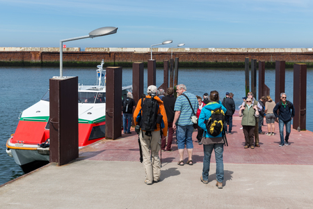 HELGOLAND, GERMANY - MAY 21, 2017: Tourists traveling with ferry between Helgoland and Dune, German islands in the Northsea Stok Fotoğraf - 79600547
