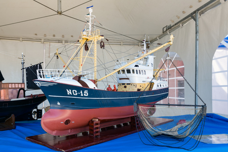 trawl: URK, THE NETHERLANDS - MAY 27, 2017: Scale model of fishing vessel at harbor of Urk during a local fishing day event
