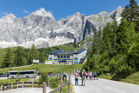 DACHSTEIN MOUNTAINS,  AUSTRIA - JULY 17, 2017: People walking to the valley station of Austrian Dachstein glacier cable car Editorial